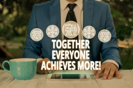 Text sign showing Together Everyone Achieves More. Business photo text Members create synergy with strong sense mutual commitment Male human wear formal work suit presenting presentation using smart device