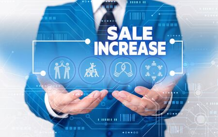 Word writing text Sale Increase. Business photo showcasing Average Sales Volume has Grown Boost Income from Leads Male human wear formal work suit presenting presentation using smart device Banco de Imagens
