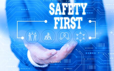 Handwriting text writing Safety First. Conceptual photo used to say that the most important thing is to be safe Male human wear formal work suit presenting presentation using smart device
