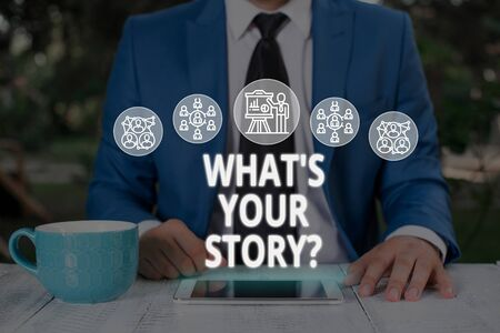 Text sign showing What S Is Your Story question. Business photo text analysisner of asking demonstrating about past life events Male human wear formal work suit presenting presentation using smart device