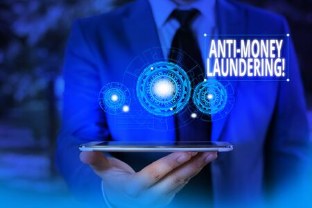 Conceptual hand writing showing Anti Money Laundering. Concept meaning regulations stop generating income through illegal actions Male wear formal suit presenting presentation smart device