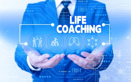 Word writing text Life Coaching. Business photo showcasing Improve Lives by Challenges Encourages us in our Careers Male human wear formal work suit presenting presentation using smart device Foto de archivo