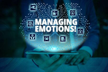 Writing note showing Managing Emotions. Business concept for ability be open to feelings and modulate them in oneself Male wear formal work suit presenting presentation smart device