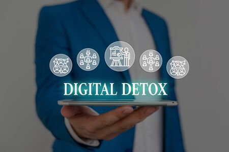 Text sign showing Digital Detox. Business photo showcasing Free of Electronic Devices Disconnect to Reconnect Unplugged Male human wear formal work suit presenting presentation using smart device
