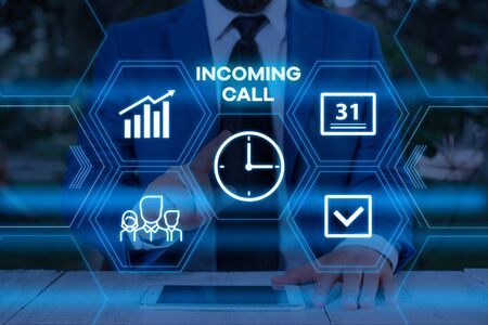 Handwriting text writing Incoming Call. Conceptual photo Inbound Received Caller ID Telephone Voicemail Vidcall Male human wear formal work suit presenting presentation using smart device Stock Photo