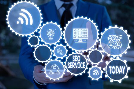 Text sign showing Seo Service. Business photo text techniques and procedures to increase the website visibility Male human wear formal work suit presenting presentation using smart device Фото со стока