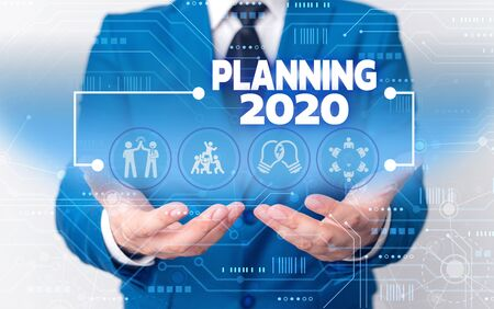 Word writing text Planning 2020. Business photo showcasing Begin with end in the Mind Positioning Long term Objectives Male human wear formal work suit presenting presentation using smart device