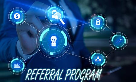 Writing note showing Referral Program. Business concept for employees are rewarded for introducing suitable recruits Male wear formal suit presenting presentation smart device