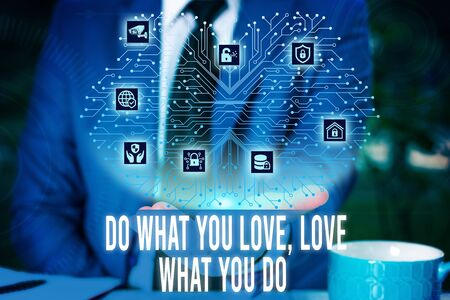 Handwriting text Do What You Love Love What You Do. Conceptual photo Pursue your dreams or passions in life Male human wear formal work suit presenting presentation using smart device