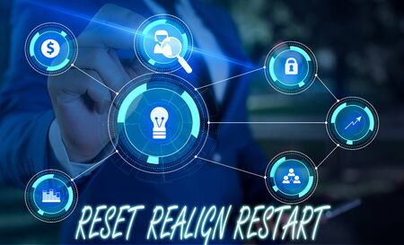 Writing note showing Reset Realign Restart. Business concept for Life audit will help you put things in perspectives Male wear formal suit presenting presentation smart device