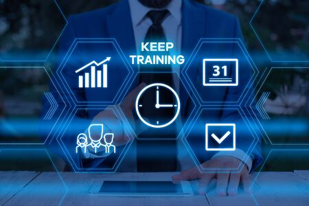 Handwriting text writing Keep Training. Conceptual photo Grounding Drilling Always Wonder Be Curious Learn Male human wear formal work suit presenting presentation using smart device Reklamní fotografie