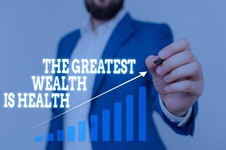Text sign showing The Greatest Wealth Is Health. Business photo showcasing Many sacrifice their money just to be healthy Male human wear formal work suit presenting presentation using smart device