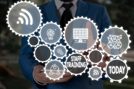 Text sign showing Staff Training. Business photo text program that helps employees learn specific knowledge Male human wear formal work suit presenting presentation using smart device