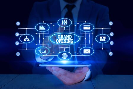 Text sign showing Grand Opening. Business photo text Ribbon Cutting New Business First Official Day Launching Male human wear formal work suit presenting presentation using smart device