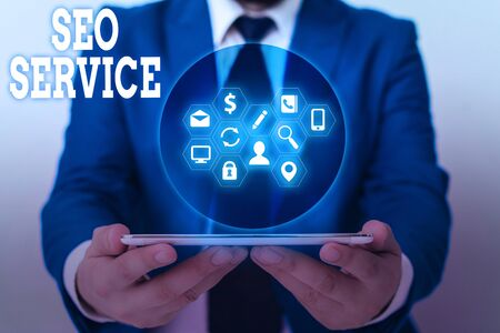 Writing note showing Seo Service. Business concept for techniques and procedures to increase the website visibility Фото со стока