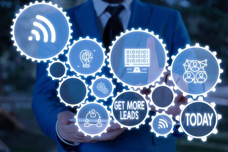 Text sign showing Get More Leads. Business photo text to have more customers and improve your target sales Male human wear formal work suit presenting presentation using smart device