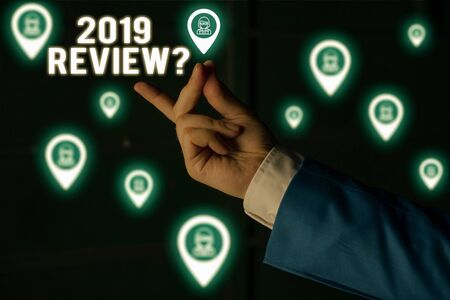 Text sign showing 2019 Review Question. Business photo showcasing remembering past year events main actions or good shows Male human wear formal work suit presenting presentation using smart device
