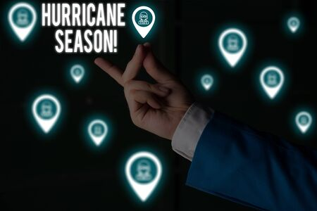Text sign showing Hurricane Season. Business photo showcasing time when most tropical cyclones are expected to develop Male human wear formal work suit presenting presentation using smart device