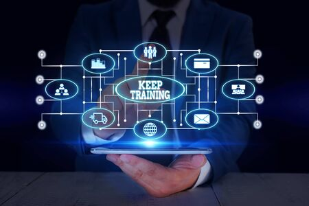 Text sign showing Keep Training. Business photo text Grounding Drilling Always Wonder Be Curious Learn Male human wear formal work suit presenting presentation using smart device
