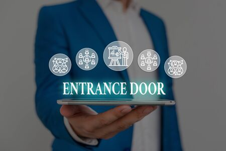 Text sign showing Entrance Door. Business photo showcasing Way in Doorway Gate Entry Incoming Ingress Passage Portal Male human wear formal work suit presenting presentation using smart device