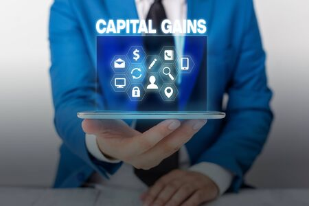 Text sign showing Capital Gains. Business photo showcasing Bonds Shares Stocks Profit Income Tax Investment Funds