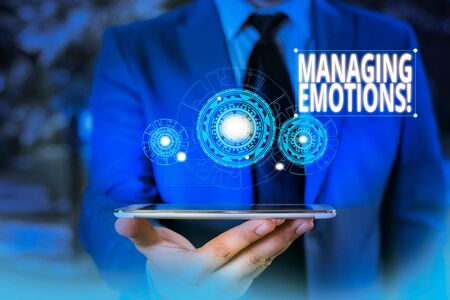 Conceptual hand writing showing Managing Emotions. Concept meaning ability be open to feelings and modulate them in oneself Male wear formal suit presenting presentation smart device