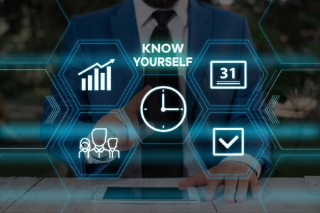 Handwriting text writing Know Yourself. Conceptual photo Find You Understanding Strength and Weaknesses Identity Male human wear formal work suit presenting presentation using smart device Stock Photo - 129721505