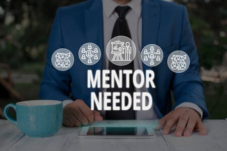 Text sign showing Mentor Needed. Business photo text wanted help for more experienced or more knowledgeable demonstrating Male human wear formal work suit presenting presentation using smart device Stockfoto