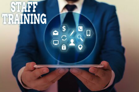 Writing note showing Staff Training. Business concept for program that helps employees learn specific knowledge Stock fotó