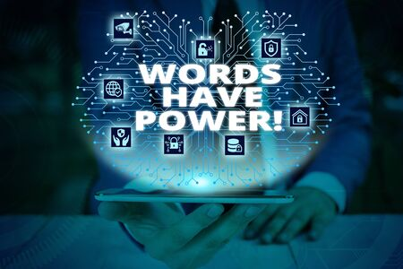 Writing note showing Words Have Power. Business concept for as they has ability to help heal hurt or harm someone Male wear formal work suit presenting presentation smart device