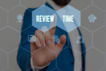 Text sign showing Review Time. Business photo text to think or talk about something again Set schedule to review Male human wear formal work suit presenting presentation using smart device Фото со стока