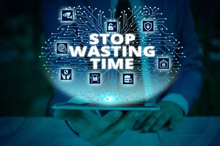 Writing note showing Stop Wasting Time. Business concept for advising demonstrating or group start planning and use it wisely Male wear formal work suit presenting presentation smart device