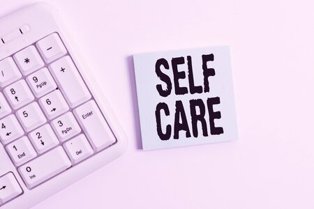Word writing text Self Care. Business photo showcasing the practice of taking action to improve one s is own health White pc keyboard with empty note paper above white background