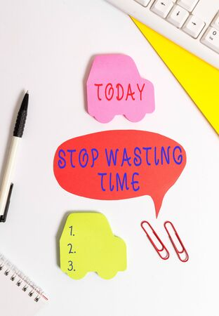 Conceptual hand writing showing Stop Wasting Time. Concept meaning advising demonstrating or group start planning and use it Red bubble copy space paper on the table with clock