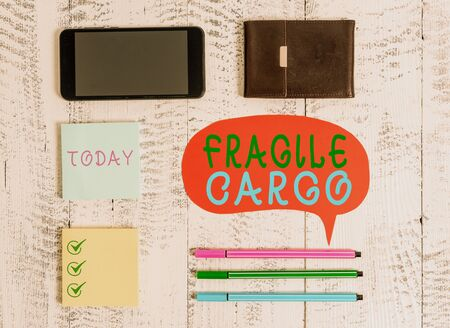 Word writing text Fragile Cargo. Business photo showcasing Breakable Handle with Care Bubble Wrap Glass Hazardous Goods Smartphone pens blank speech bubble sticky notes wallet wooden background