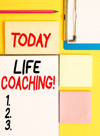 Conceptual hand writing showing Life Coaching. Concept meaning demonstrating employed to help showing attain their goals in career Empty papers with copy space on yellow background table
