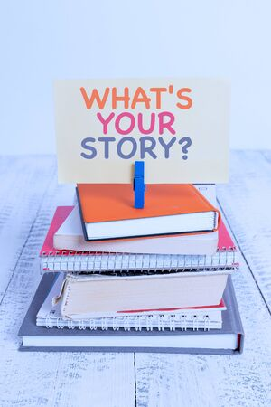Conceptual hand writing showing What S Is Your Story question. Concept meaning analysisner of asking demonstrating about past life events pile stacked books notebook pin color reminder white wooden