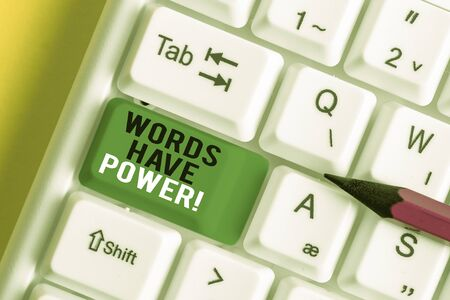 Writing note showing Words Have Power. Business concept for as they has ability to help heal hurt or harm someone White pc keyboard with note paper above the white background