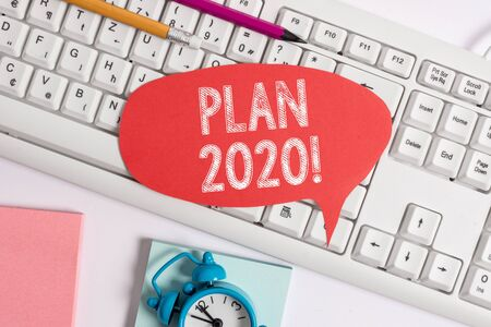 Handwriting text Plan 2020. Conceptual photo detailed proposal doing achieving something next year Empty copy space red note paper bubble above pc keyboard for text message