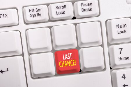 Conceptual hand writing showing Last Chance. Concept meaning final opportunity to achieve or acquire something you want White pc keyboard with note paper above the white background