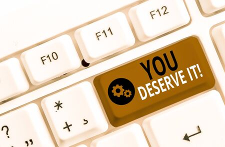 Handwriting text You Deserve It. Conceptual photo should have it because of their qualities or actions White pc keyboard with empty note paper above white background key copy space