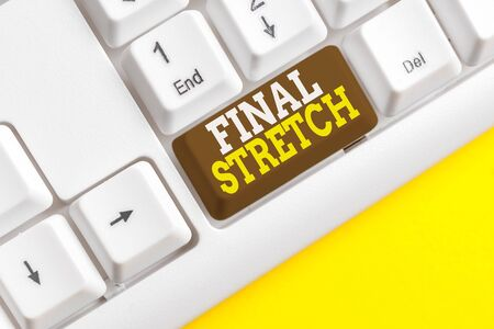 Word writing text Final Stretch. Business photo showcasing Last Leg Concluding Round Ultimate Stage Finale Year ender White pc keyboard with empty note paper above white background key copy space Imagens