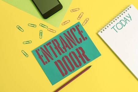 Word writing text Entrance Door. Business photo showcasing Way in Doorway Gate Entry Incoming Ingress Passage Portal Blank spiral notepad pencil clips smartphone paper sheets color background Stock Photo
