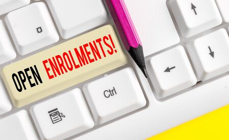 Word writing text Open Enrolments. Business photo showcasing when employees may make changes to elected fringe benefit White pc keyboard with empty note paper above white background key copy space 写真素材 - 129835414