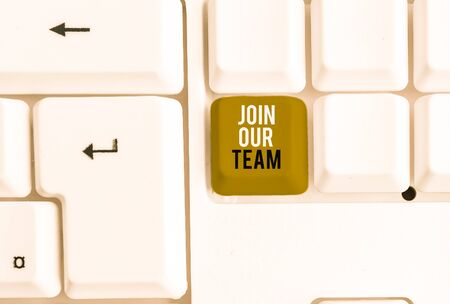 Text sign showing Join Our Team. Business photo showcasing inviting someone to join in your local group or company White pc keyboard with empty note paper above white background key copy space