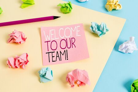 Writing note showing Welcome To Our Team. Business concept for introducing another demonstrating to your team mates Colored crumpled papers empty reminder blue yellow clothespin