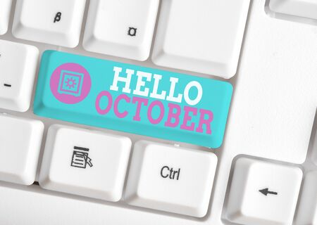 Writing note showing Hello October. Business concept for Last Quarter Tenth Month 30days Season Greeting White pc keyboard with note paper above the white background