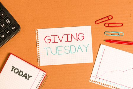Writing note showing Giving Tuesday. Business concept for international day of charitable giving Hashtag activism Cardboard notebook office study supplies chart paper