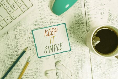 Writing note showing Keep It Simple. Business concept for to make something easy to understand and not in fancy way Technological devices colored reminder paper office supplies