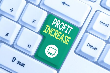 Text sign showing Profit Increase. Business photo text the growth in the amount of revenue gained from a business White pc keyboard with empty note paper above white background key copy space